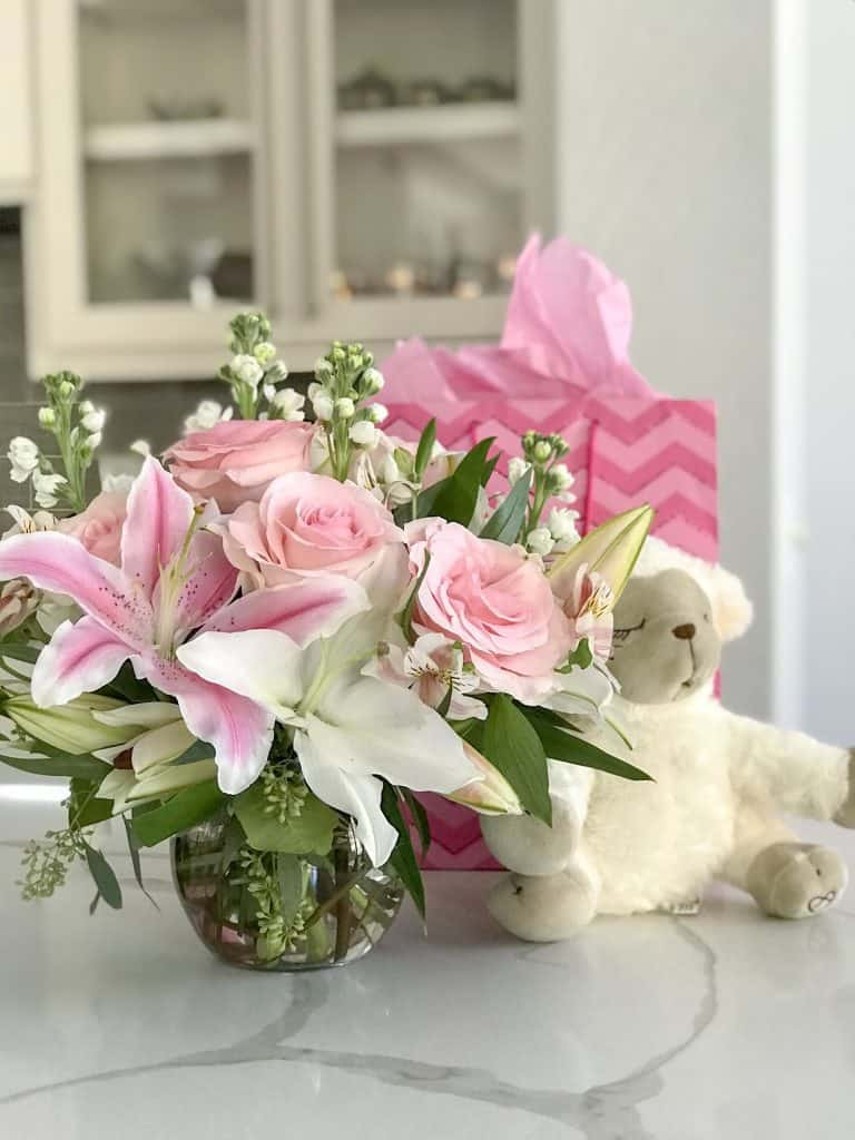 Flowers and teddy bear on table: my birth story