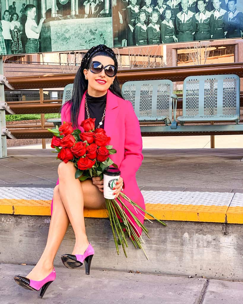 Valentine's Day outfit with pink coat pink and black heels with red roses