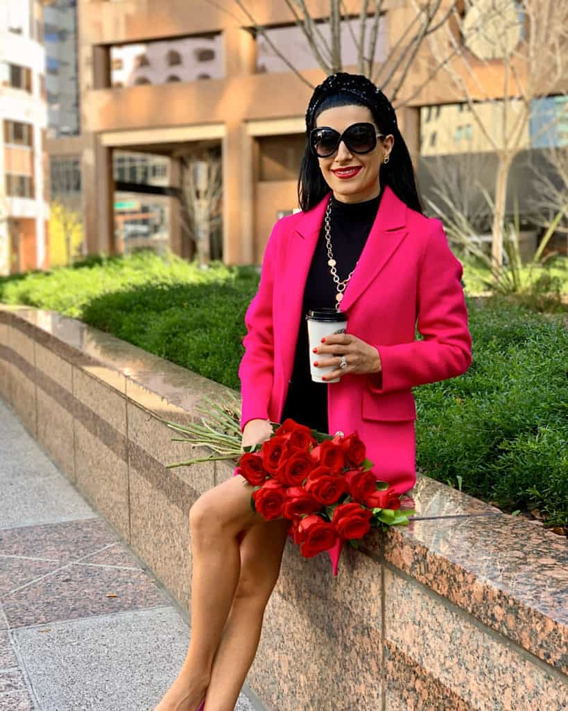 Valentine's Day outfit with pink coat with red roses