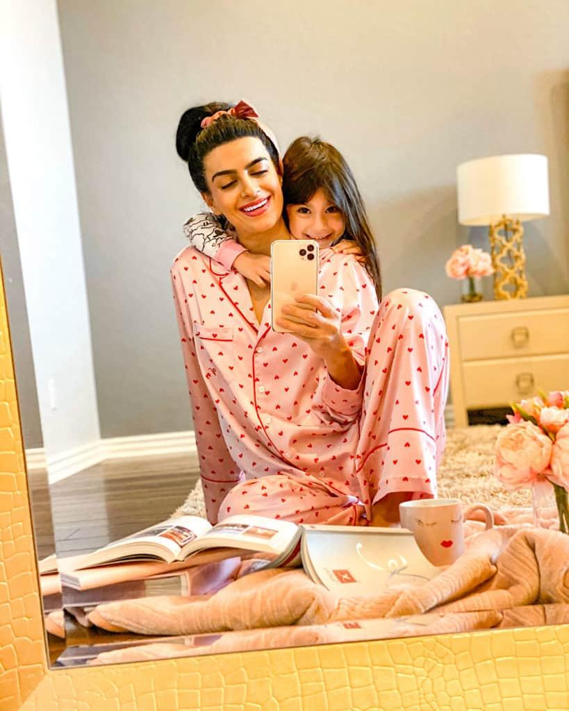 woman in Valentine's pyjamas with child