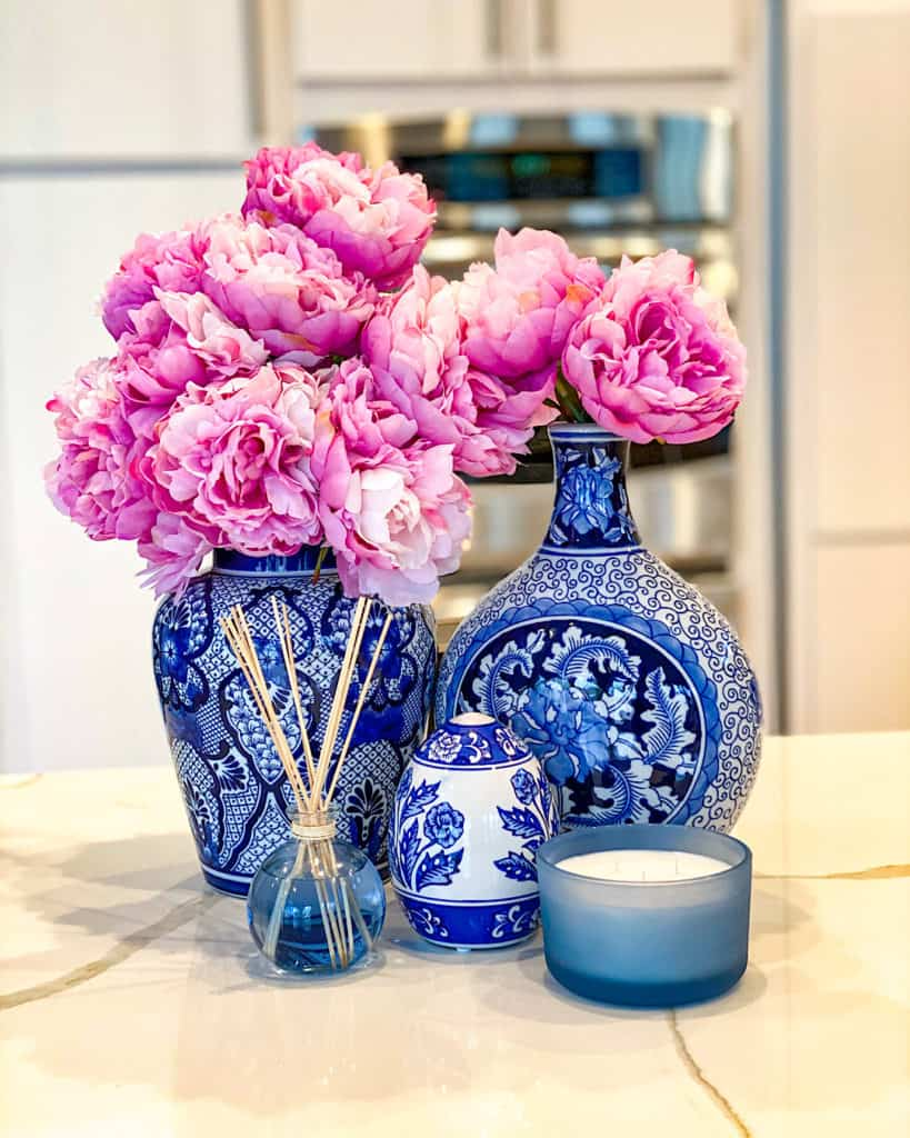 Pink peonies in blue and white vases - a splash of color is a great way to freshen up your kitchen for spring