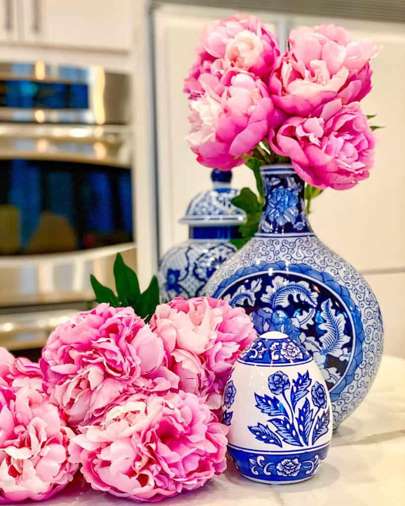 Freshly cut flowers in blue vase in kitchen