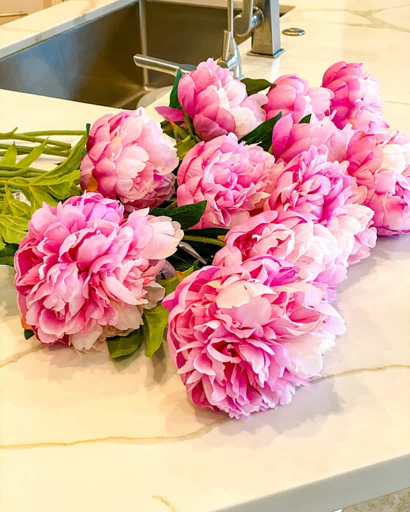 Freshly cut pink peonies on kitchen counter