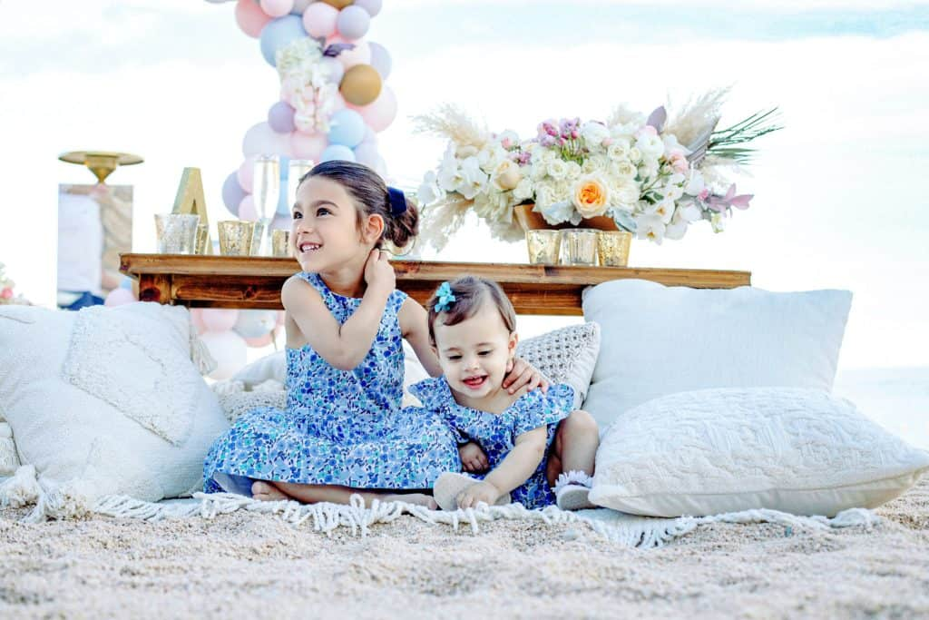 Sisters in matching outfits at the beach birthday party