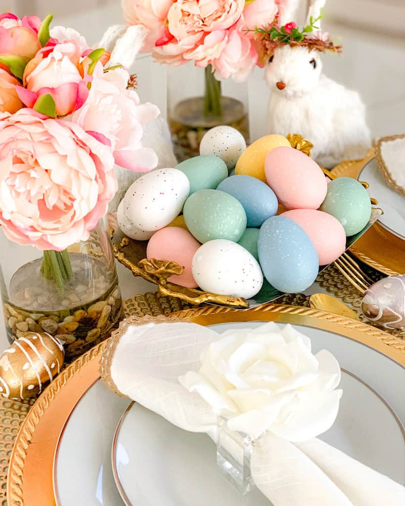 Handpainted eggs, bunnies and fresh flowers make a beautiful Easter table setting