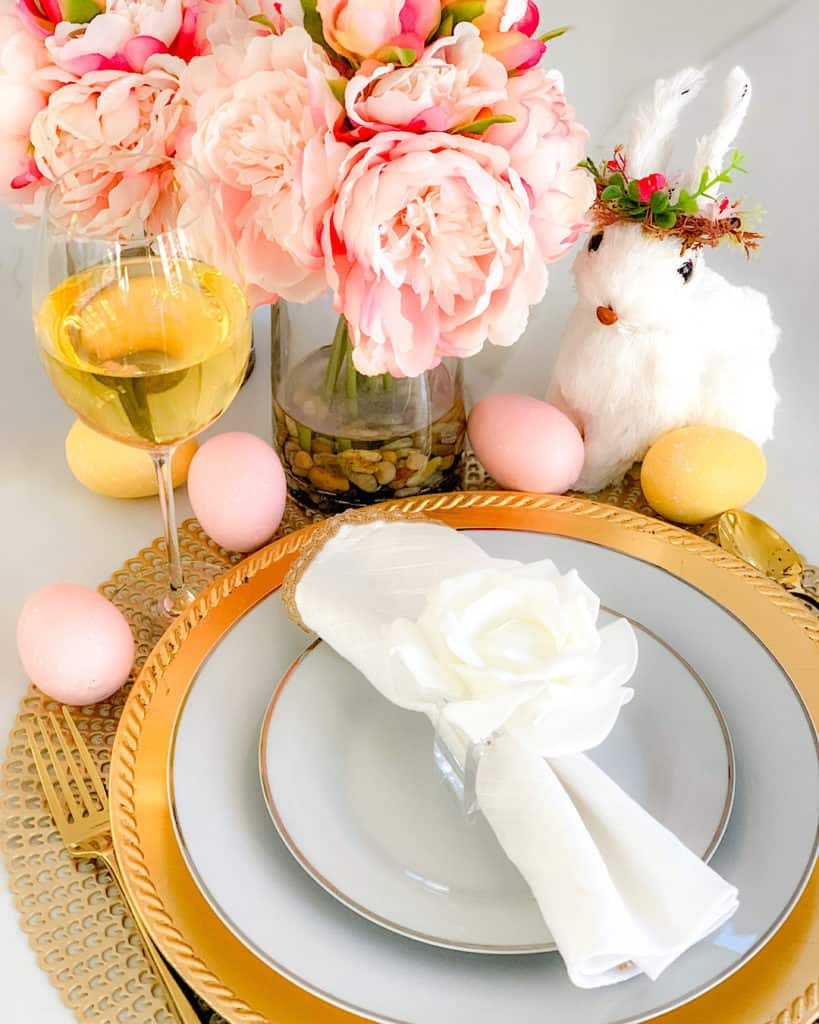 Glass of wine alongside decoration ideas for Easter