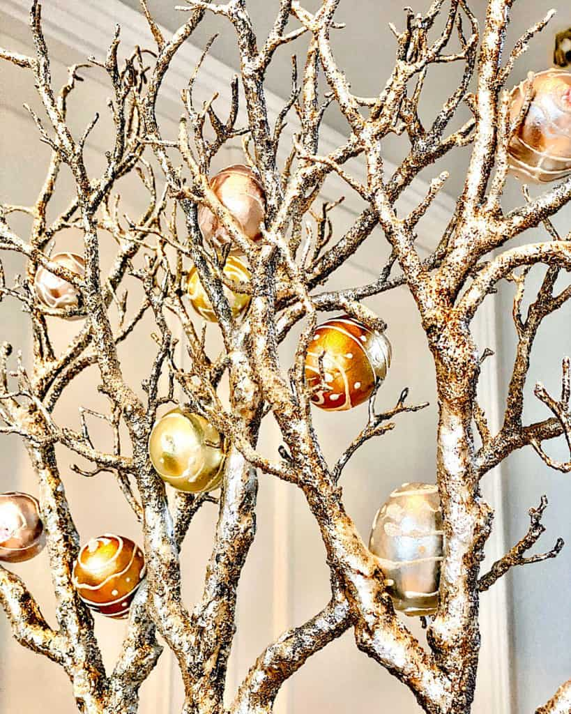 Hang some Easter eggs on decorative branches at home for an easy Easter decoration idea