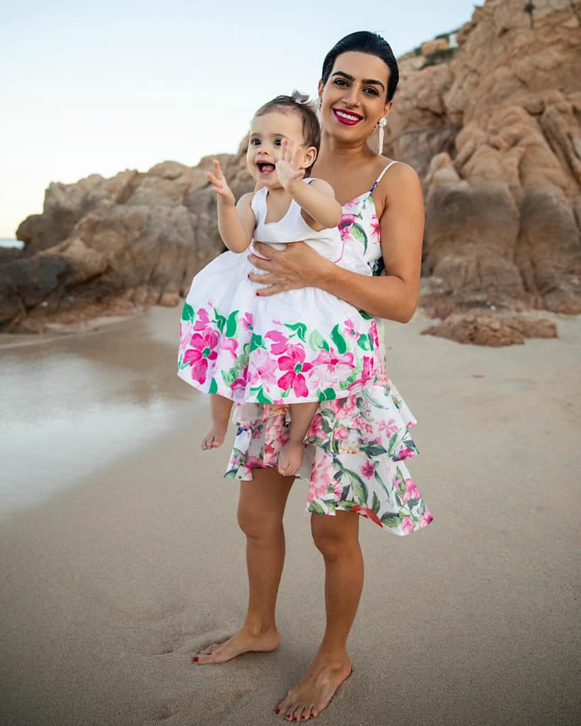 Mother and daughter on beach at Montage Los Cabos, Cabo
