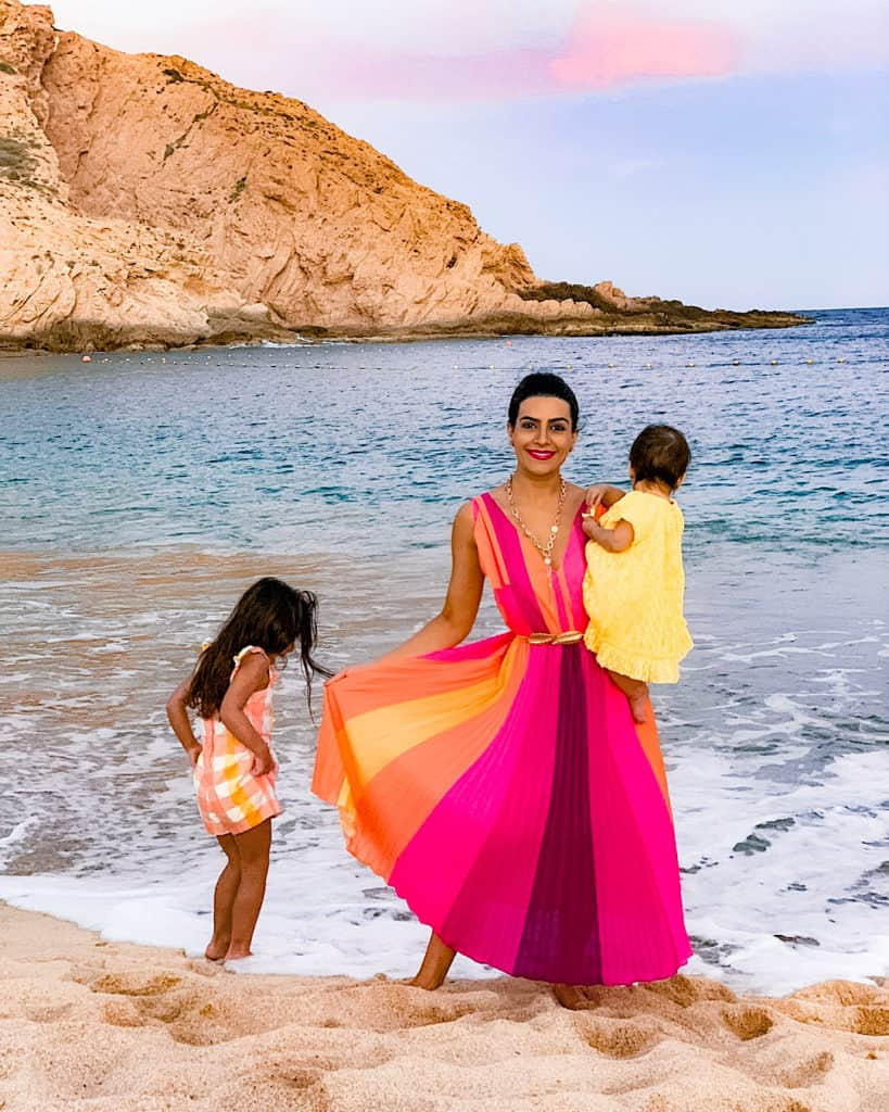 Mother and daughters at sunset playing on the beach at Montage Los Cabos, Cabo san Lucas