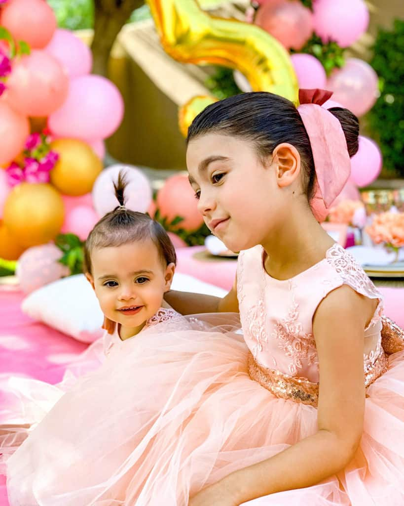 How to throw a quarantine birthday party at home - sisters in matching dresses