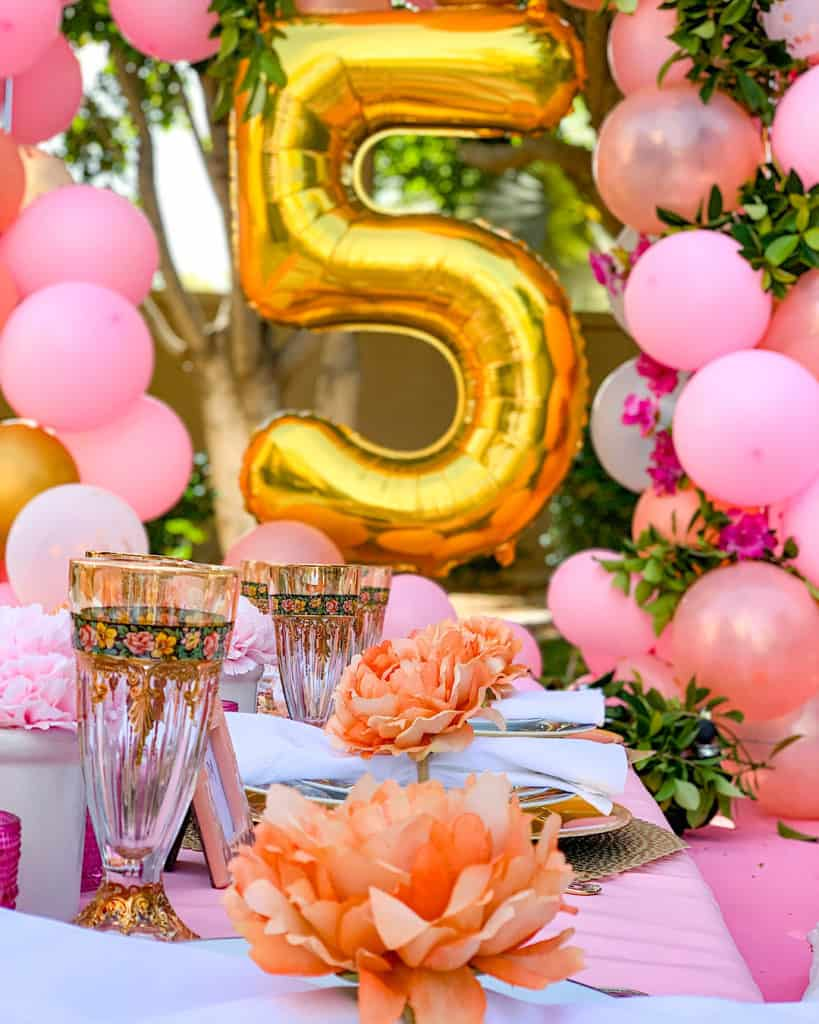 Pretty table with place settings for   5th birthday party at home: Quarantine party ideas