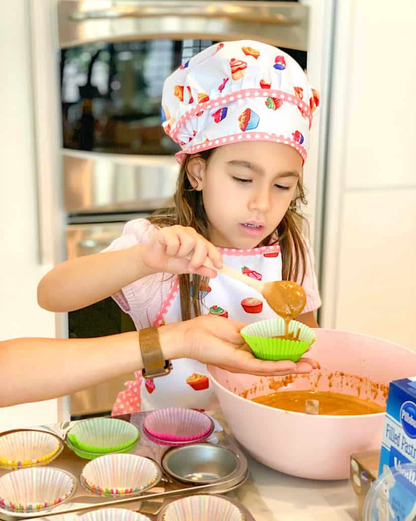 My daughter making cupcakes - such simple baking recipes to try with your kids