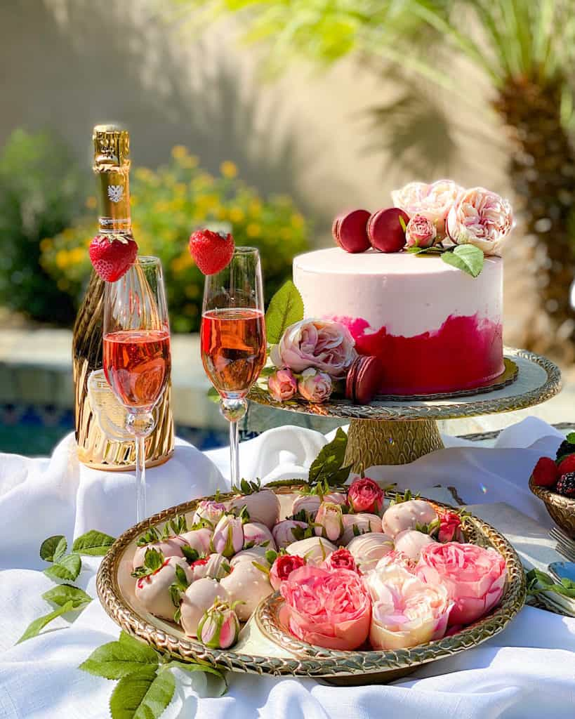 Dessert Table Design Tips - consider your colors. Pink champagne and pink cake with pink flowers.