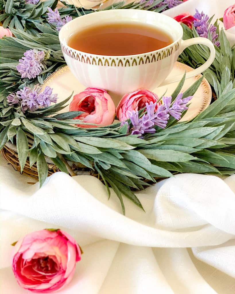 Dessert Table Design Tips: create different heights. Teacup and camelia and leaf decorations.