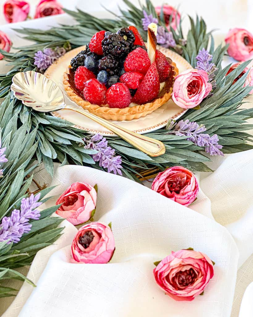 Fruit tart with flower decorations