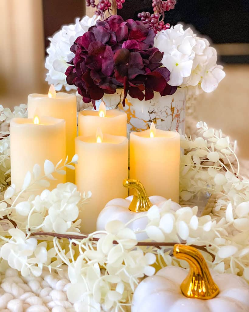 Fall themed white and red hydrangeas with candle display