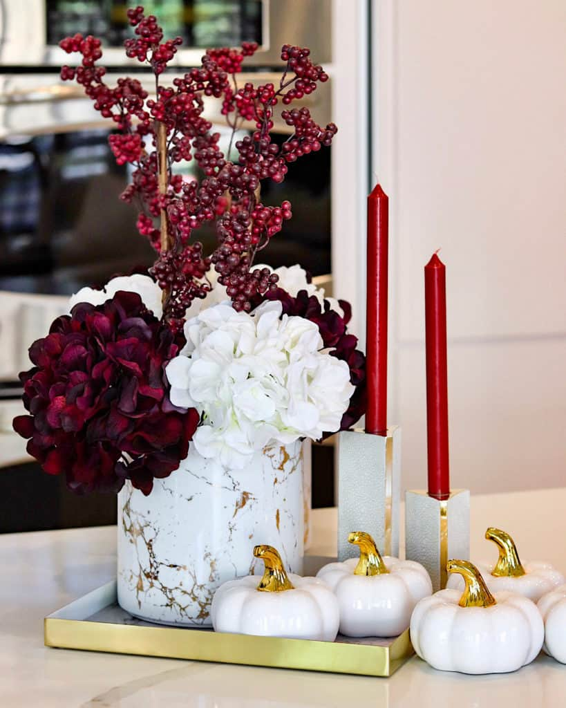 Ideas for fall decor: candles, flowers and ceramic pumpkins