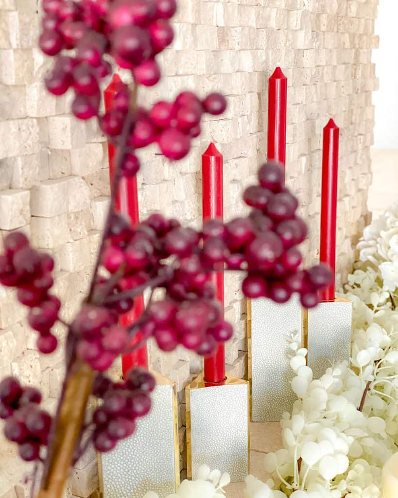Styling your mantel for fall: candles and faux flowers in burgundy and white
