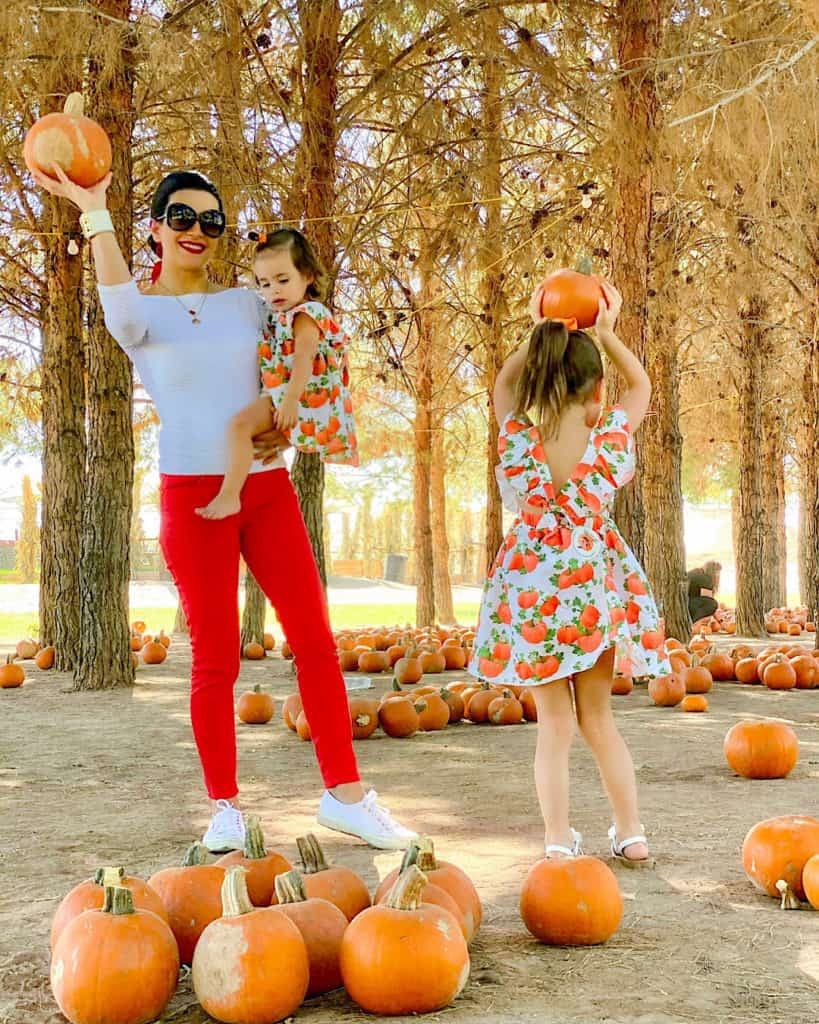 Tips for taking your toddler to the pumpkin patch: take a camera so you can capture memories