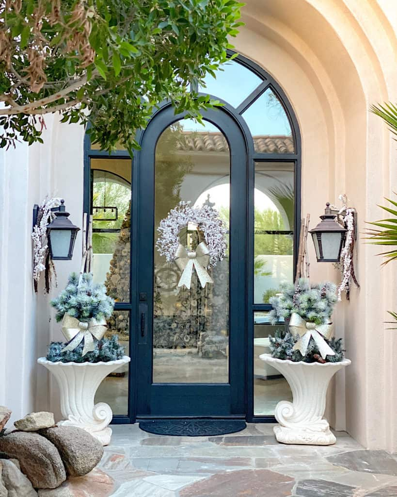 "For our wooden front door, we chose Behr ""Black Matte Exterior""."