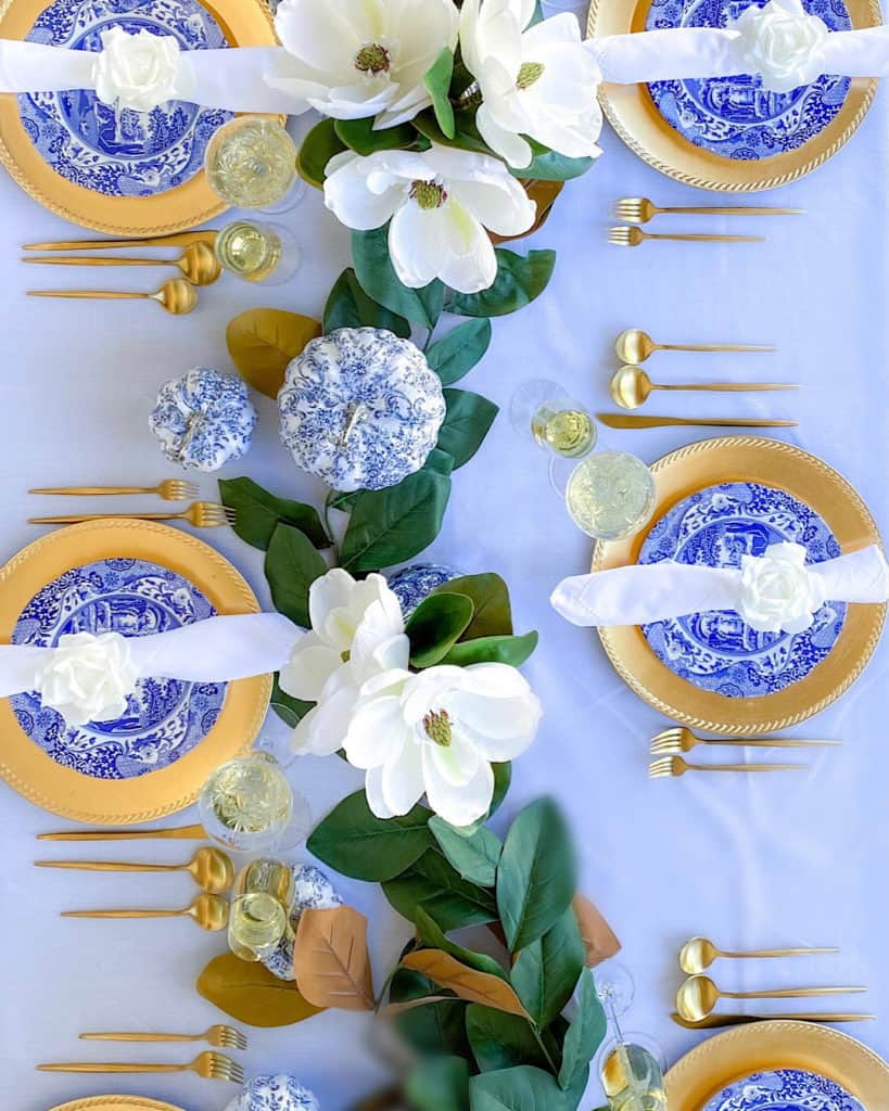aerial shot of place settings and table foliage for my Capri blue and white Thanksgiving tablescape