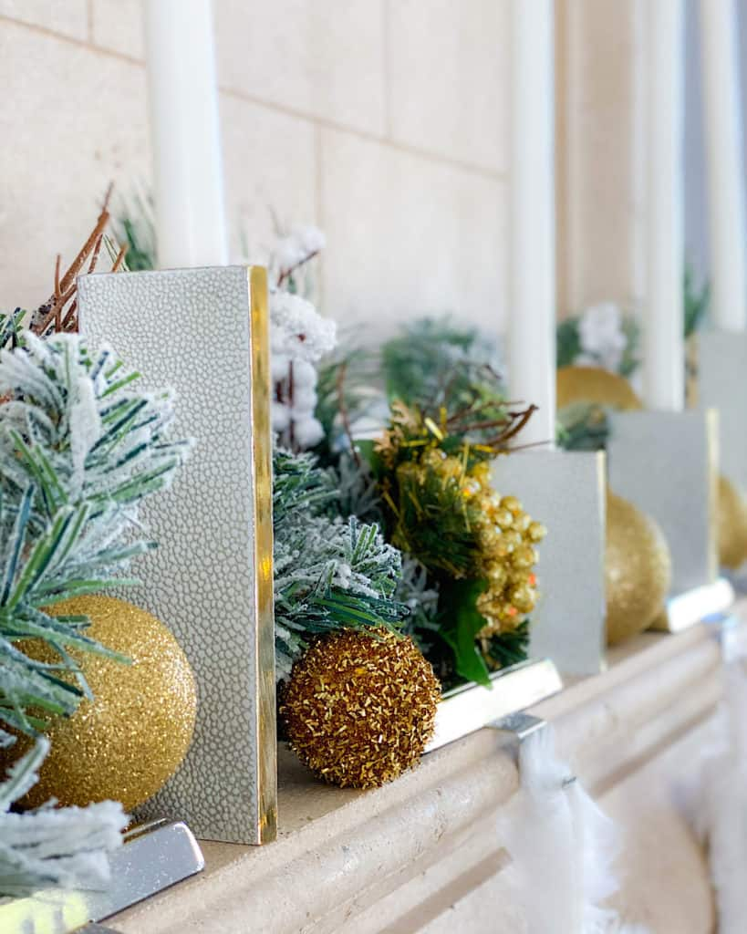 White and Gold Christmas decorations on mantle.