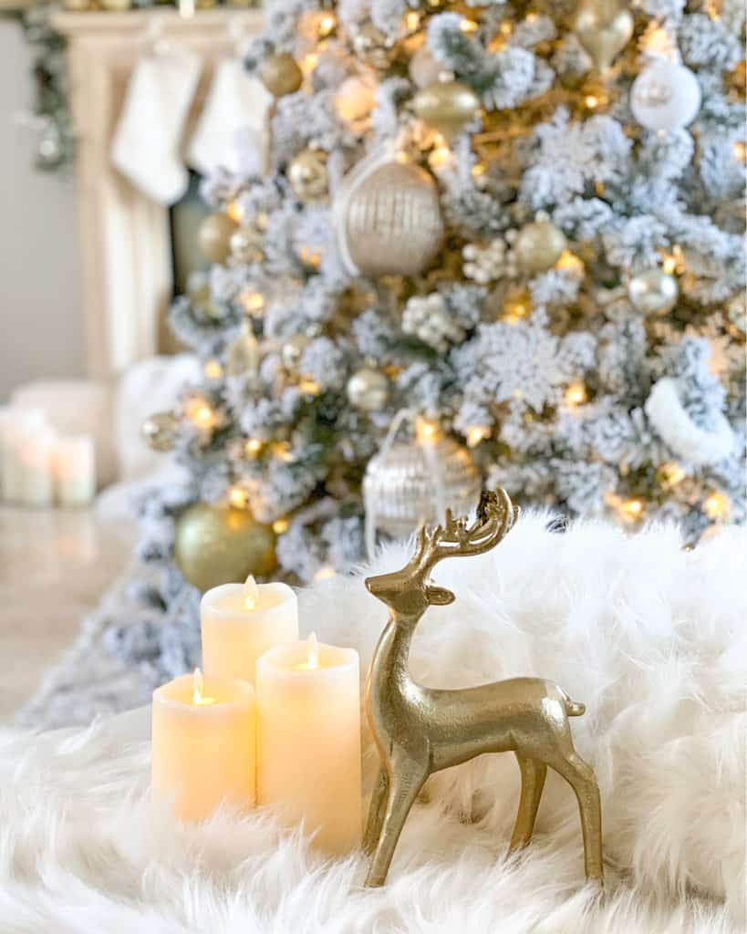White and Gold Christmas decorations - white candles, gold reindeer.