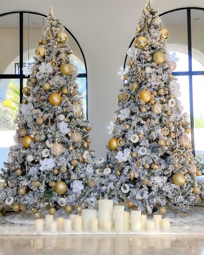 Two White and Gold Christmas trees side by side