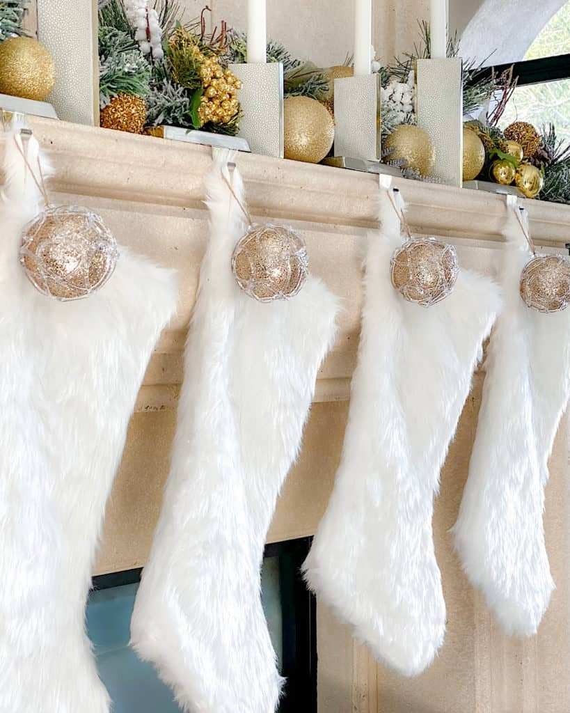 White stockings with gold baubles.