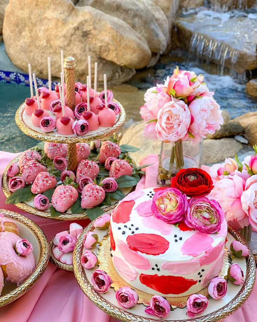 Pink, red and white Valentine's Day cakes on a dessert Table