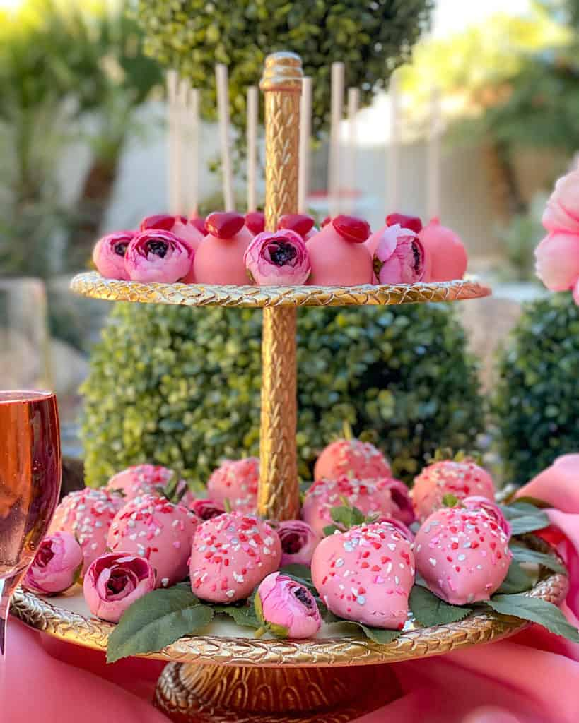Gold Valentine's Day Cake stand with pink desserts
