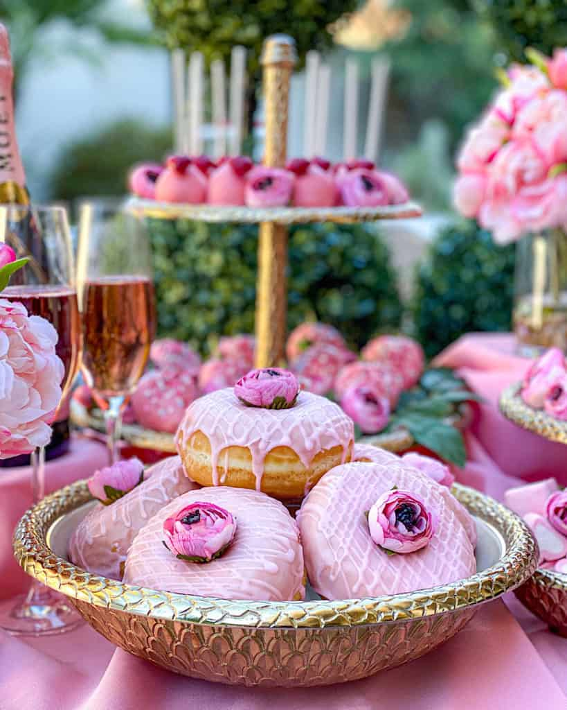 Pink donuts on a Valentine's Day Dessert Table
