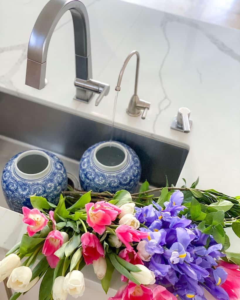 Blue and white vases and freshly cut flowers.