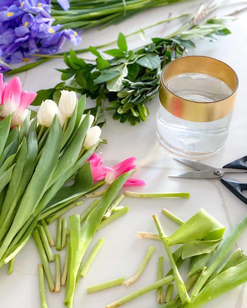 Fresh cut flowers, vase, scissors