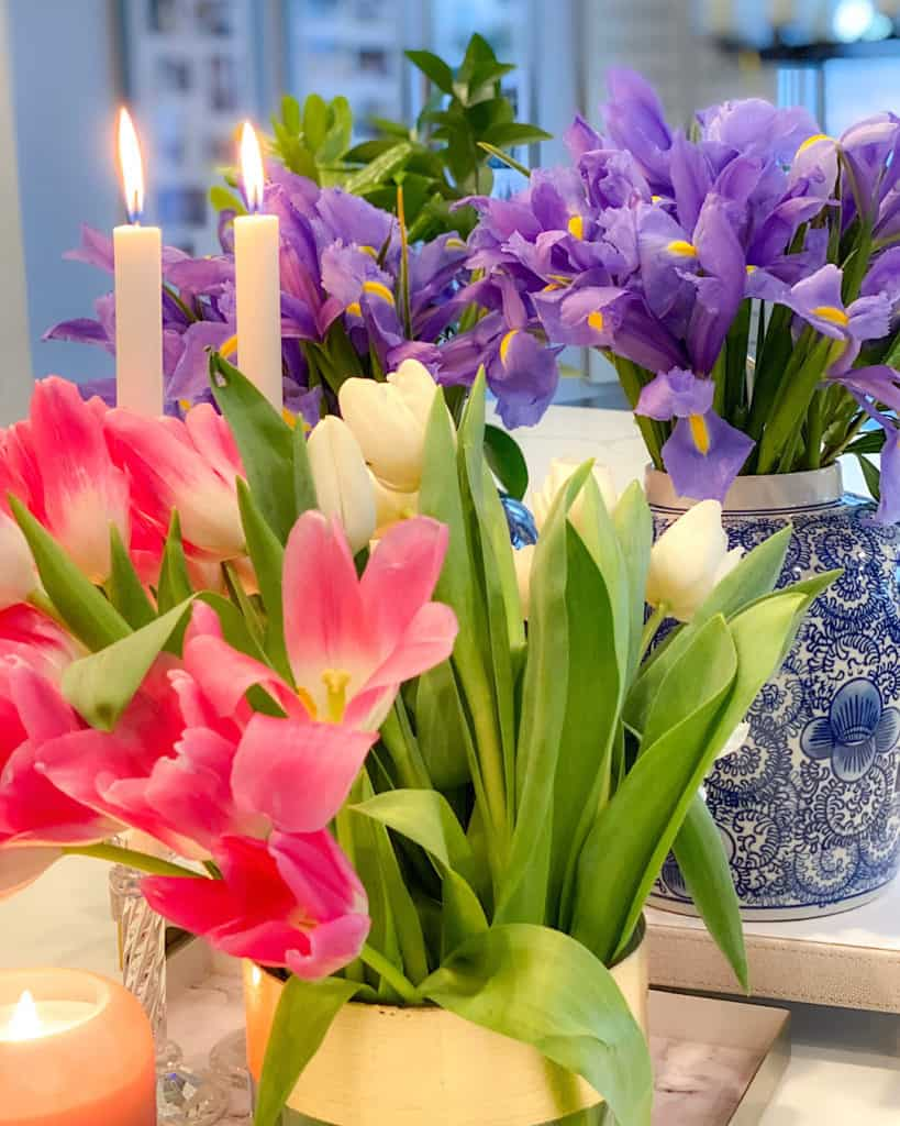 Spring flower arrangements and candle.