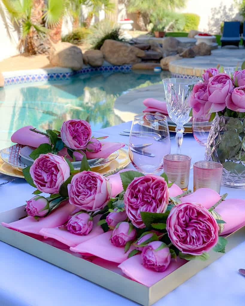 Roses at birthday party place setting
