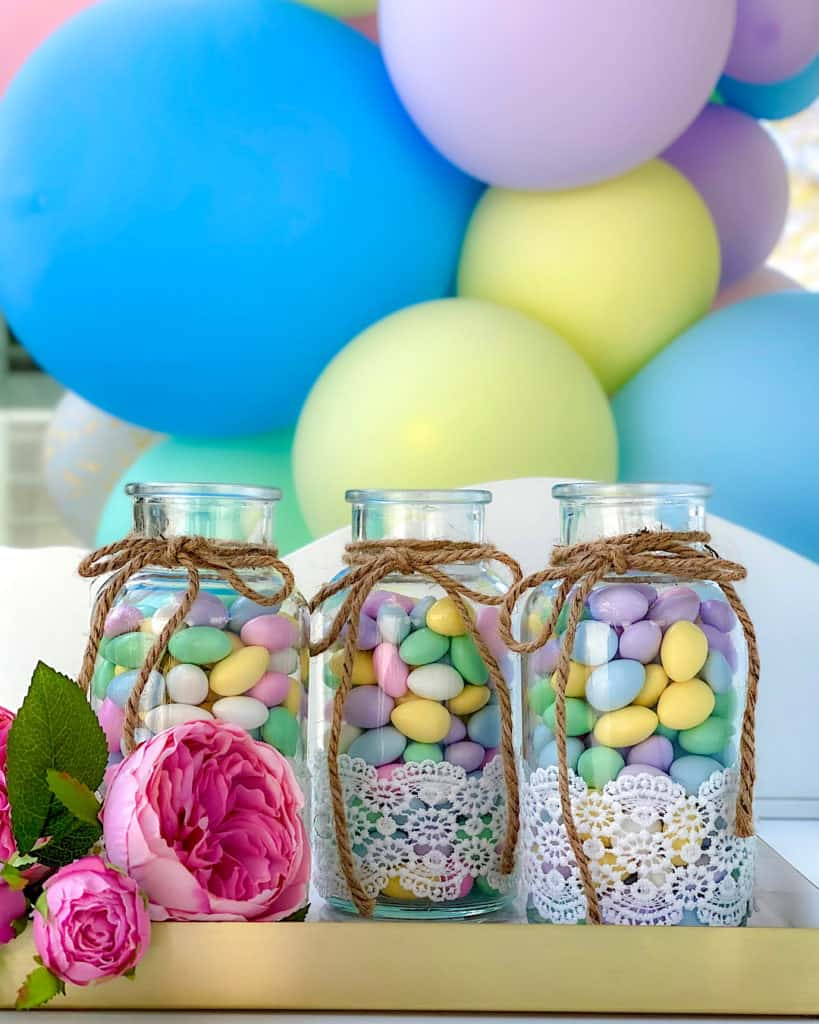 Pretty jars of candy at birthday party dessert table.