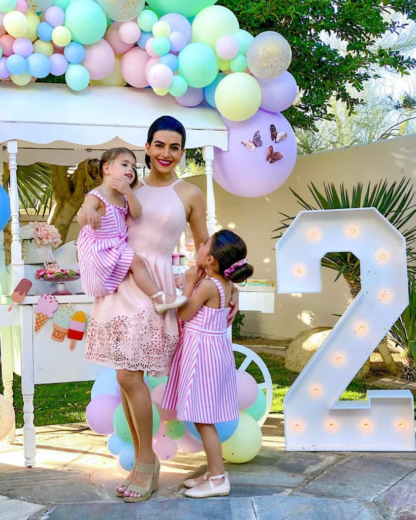 Mother and daughters at ice cream birthday party for 2 year old