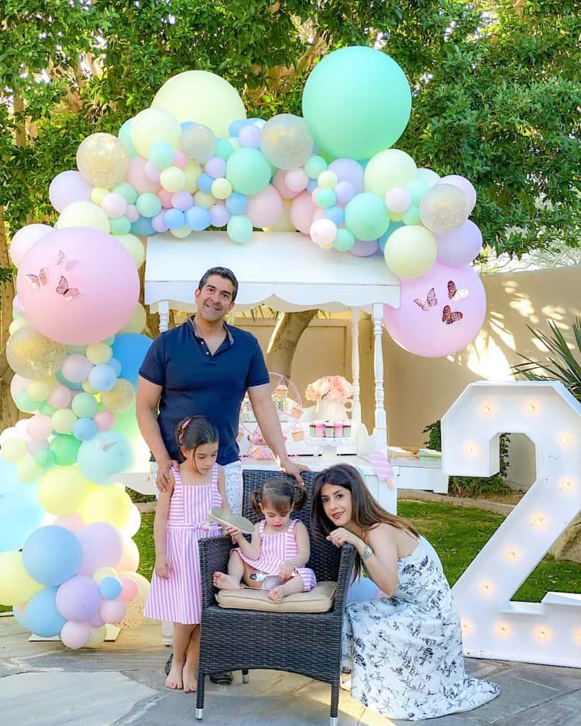 Family portrait beside ice cream cart