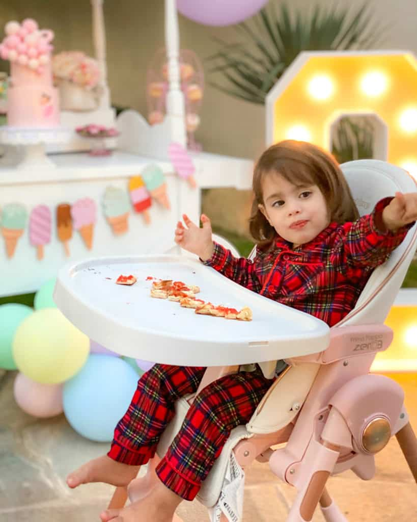 2 year old girl in pyjamas at birthday party
