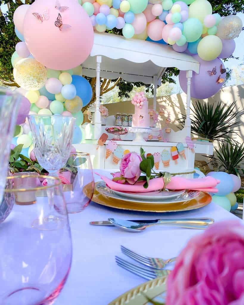 Place settings and tablescape at ice cream themed birthday party.