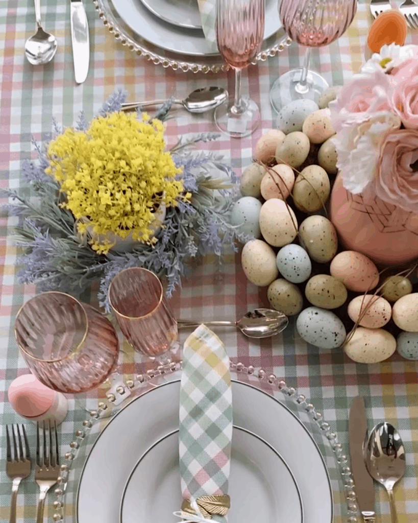Easter Sunday place setting with easter egg candy and pink glassware