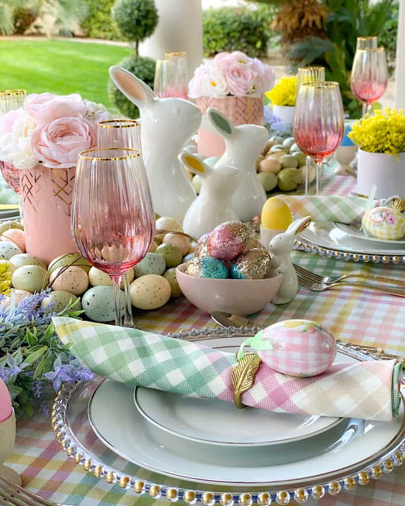 Easter Sunday brunch table with decorative ceramic bunnies and Easter decorations