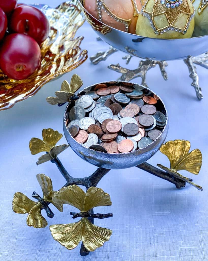 Nowruz table decorations: sekeh, bowl of coins