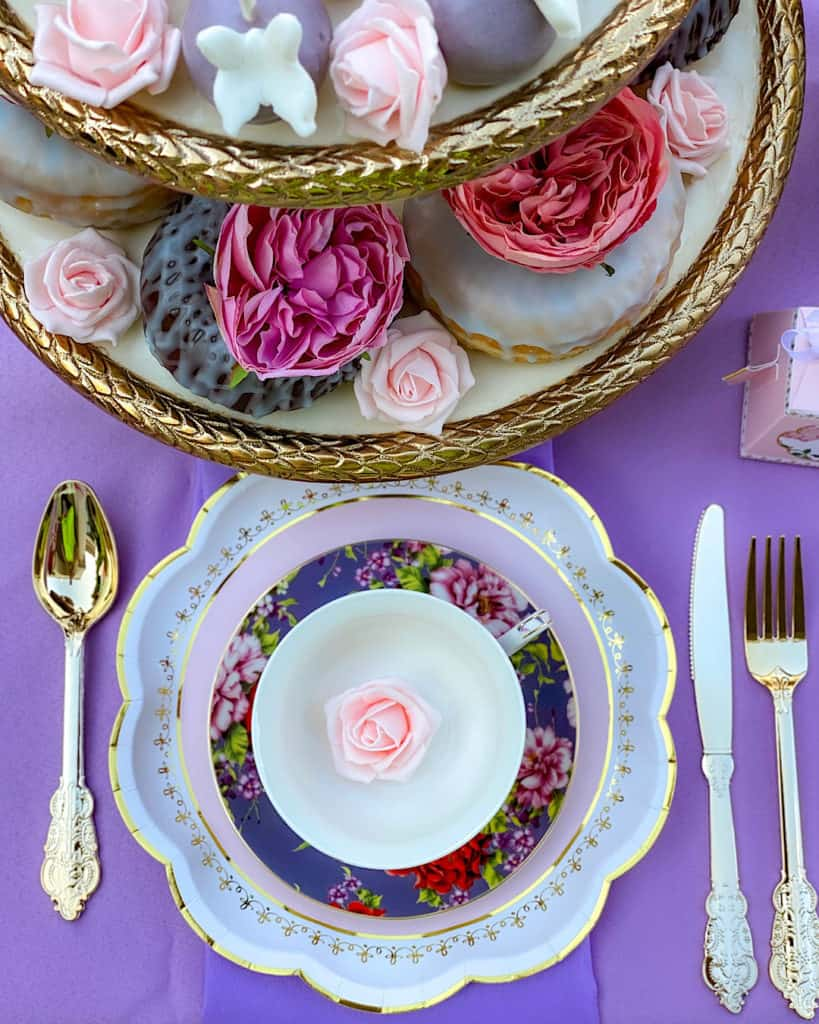 Rose in a teacup on a place setting