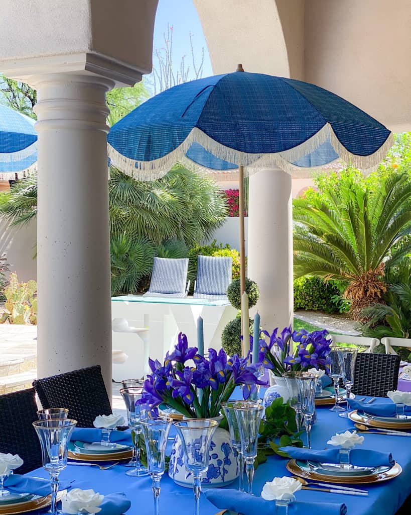 Garden tea party top table with Irises on a blue tablecloth.