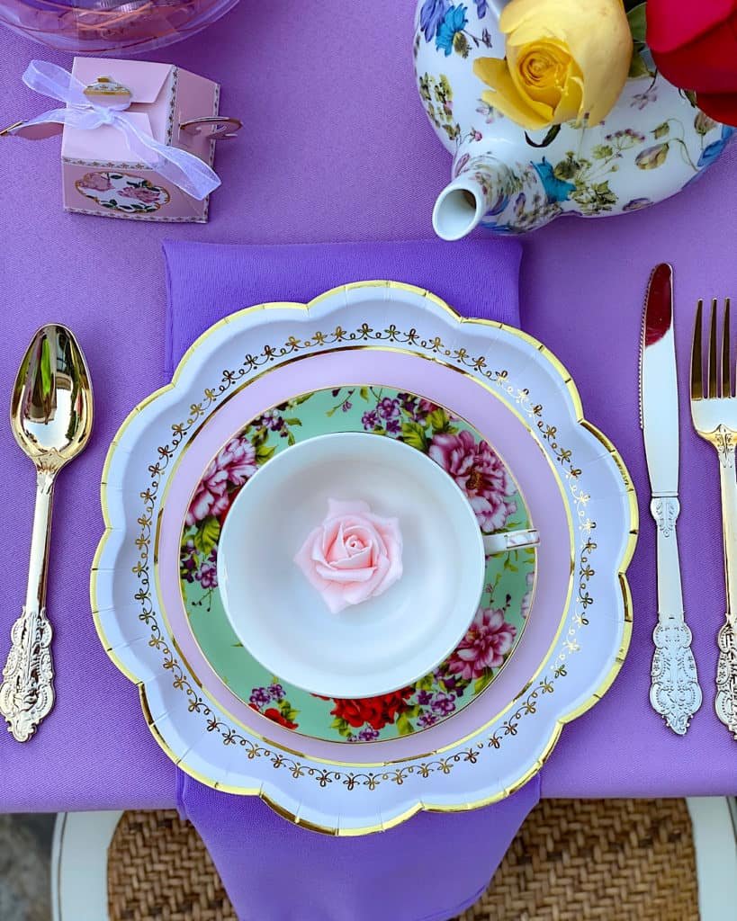 Place setting with rose decoration in a cup and saucer