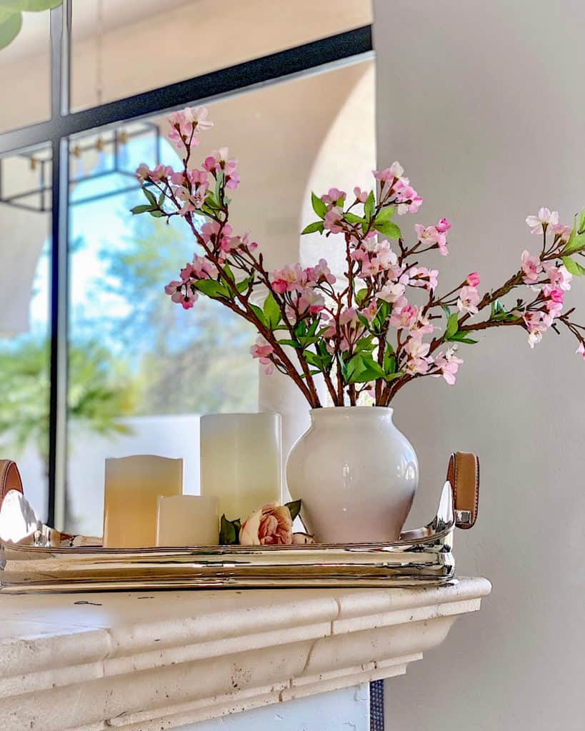 Mantle decorated for spring with flowers and candles