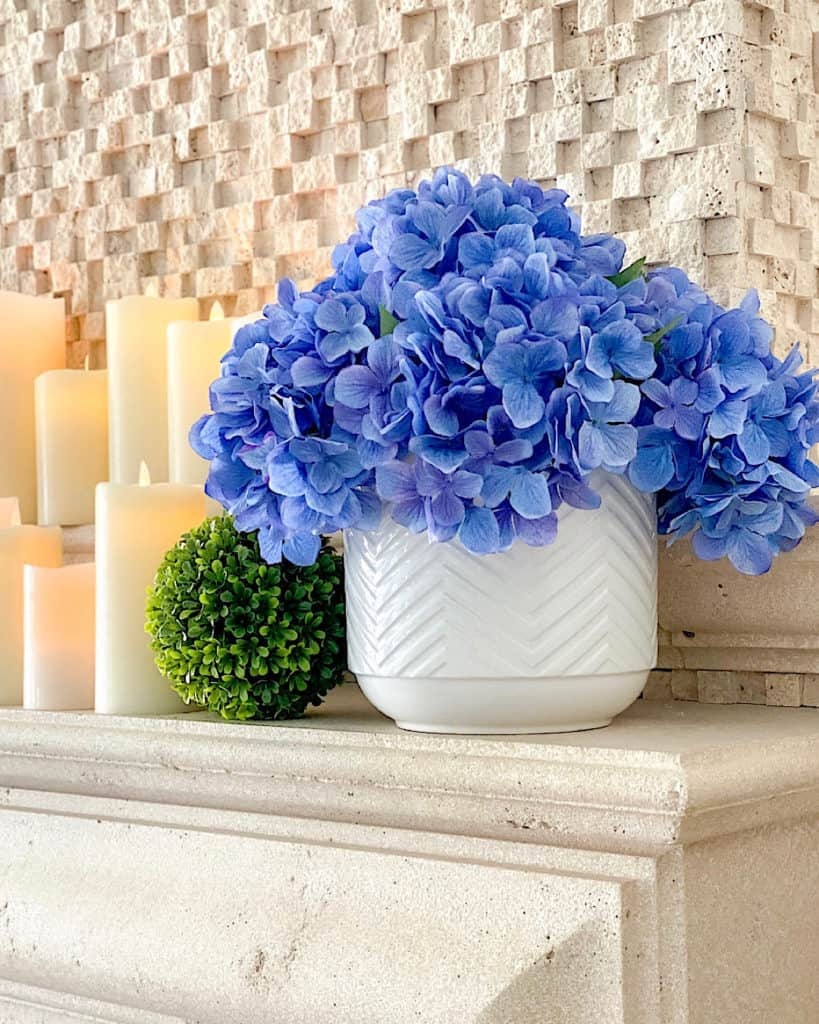 mantel decorating ideas for spring: hydrangea display and candles