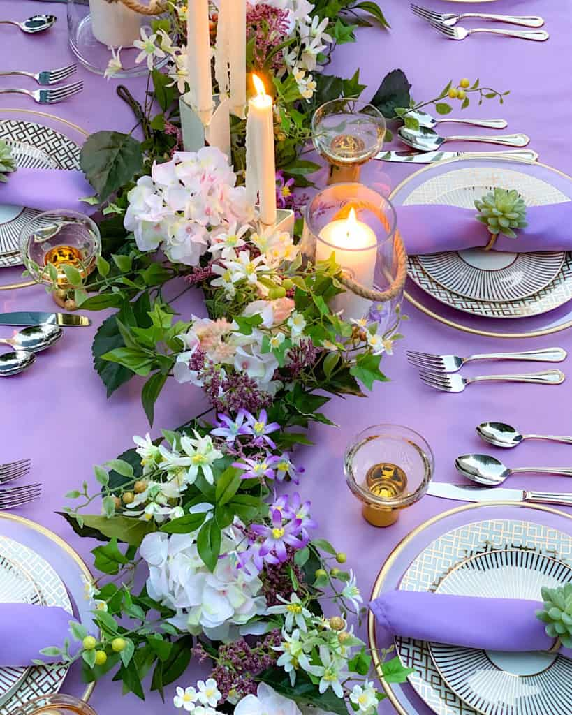 Candle and flower centrepiece on spring or summer brunch tablescape
